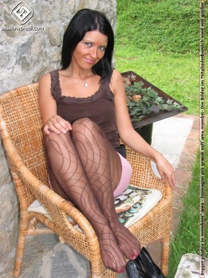 Babe in top and shorts drops black heels to show off sexy legs in black pantyhose - XXXonXXX - Pic 9