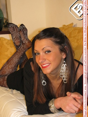 Pretty babe in black dress and heels shows hot legs in black and white pantyhose - XXXonXXX - Pic 7