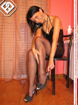 Sexy girl in hot short black dress sits on chair to display cute tempting feet - XXXonXXX - Pic 3