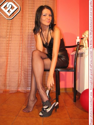 Sexy girl in hot short black dress sits on chair to display cute tempting feet - XXXonXXX - Pic 4