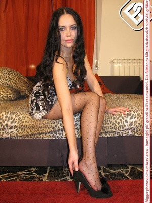 Busty seductress in short sexy dress models sexy feet and legs in hot pantyhose - XXXonXXX - Pic 1