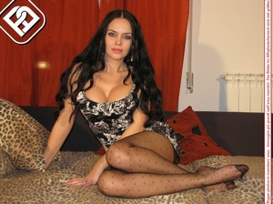 Busty seductress in short sexy dress models sexy feet and legs in hot pantyhose - XXXonXXX - Pic 3