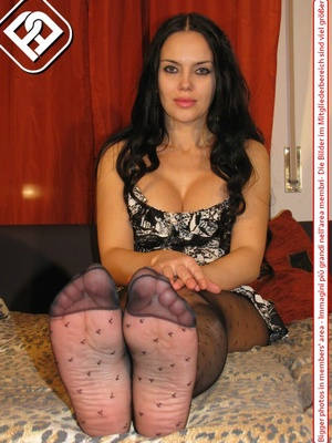 Busty seductress in short sexy dress models sexy feet and legs in hot pantyhose - XXXonXXX - Pic 5