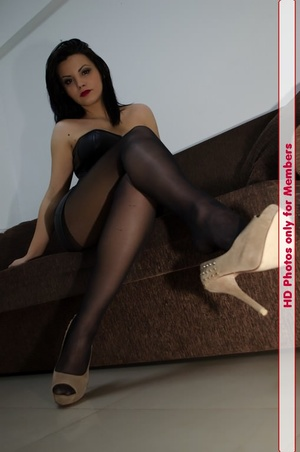 Cutie in black leather corset and black pantyhose shows sweet legs in cream heels - XXXonXXX - Pic 3