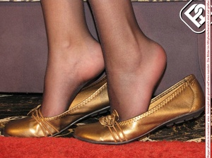 Black hair beauty in gold flat shoes, matching dress and black pantyhose - XXXonXXX - Pic 1
