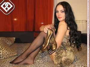 Black hair beauty in gold flat shoes, matching dress and black pantyhose - XXXonXXX - Pic 10