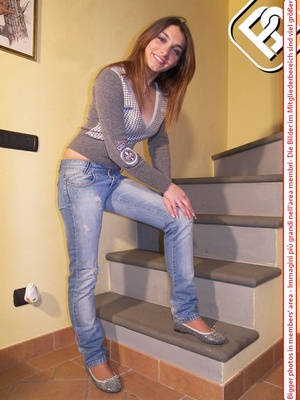 Hot young chick in blue jeans, top and silver flat shoes shows sexy feet on stairs - XXXonXXX - Pic 1