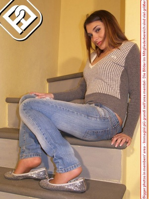Hot young chick in blue jeans, top and silver flat shoes shows sexy feet on stairs - XXXonXXX - Pic 5