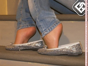 Hot young chick in blue jeans, top and silver flat shoes shows sexy feet on stairs - XXXonXXX - Pic 6