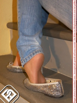 Hot young chick in blue jeans, top and silver flat shoes shows sexy feet on stairs - XXXonXXX - Pic 7