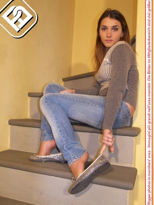 Hot young chick in blue jeans, top and silver flat shoes shows sexy feet on stairs - XXXonXXX - Pic 8