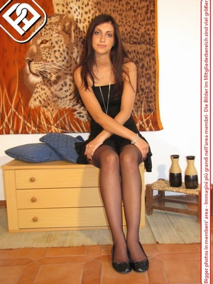 Young tall temptress in black dress, black pantyhose and shoes displays sexy feet - XXXonXXX - Pic 2