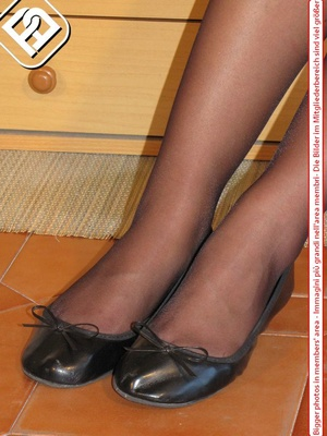 Young tall temptress in black dress, black pantyhose and shoes displays sexy feet - XXXonXXX - Pic 4