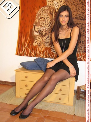 Young tall temptress in black dress, black pantyhose and shoes displays sexy feet - XXXonXXX - Pic 5