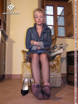 Madam in black heels and fishnets displaying her legs and feet. - XXXonXXX - Pic 4