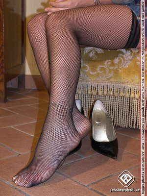 Madam in black heels and fishnets displaying her legs and feet. - XXXonXXX - Pic 6