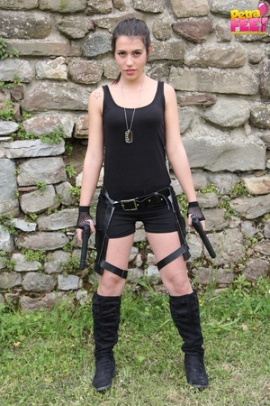 Superb trollop dressed like Lara Croft takes off her boots. - XXXonXXX - Pic 3