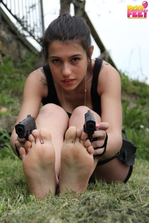 Superb trollop dressed like Lara Croft takes off her boots. - XXXonXXX - Pic 7
