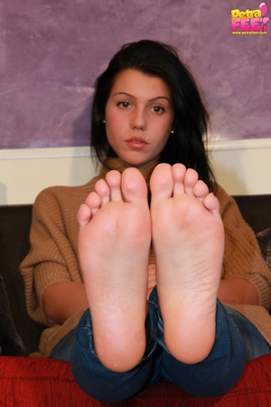 Adorable bitch gets out of her brown booties to show her stockinged feet. - XXXonXXX - Pic 9