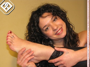 Delicious lass removes her black heels to reveal toe nails painted red. - XXXonXXX - Pic 2