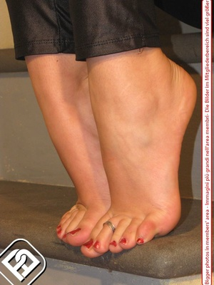 Delicious lass removes her black heels to reveal toe nails painted red. - XXXonXXX - Pic 4