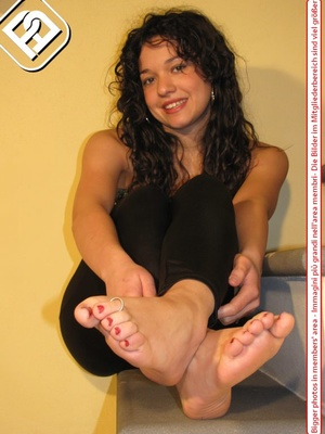 Delicious lass removes her black heels to reveal toe nails painted red. - XXXonXXX - Pic 8