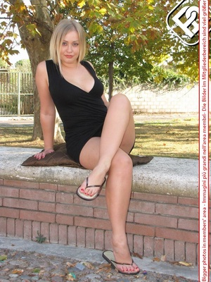 Knockout tart in flip flops displaying her yummy feet with red toe nails. - XXXonXXX - Pic 1