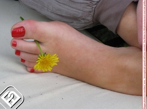 Alluring broad on a white bench showing off her red painted toe nails. - XXXonXXX - Pic 4
