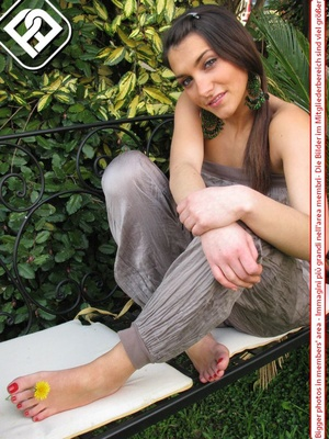 Alluring broad on a white bench showing off her red painted toe nails. - XXXonXXX - Pic 5