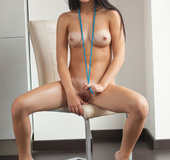Yummy brunette vamp wearing a blue bead necklace…