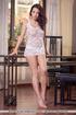 Delish trollop in a white lacy nightie poses nude…