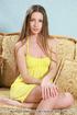 Tasty doe in a yellow nightie shows off her snatch…