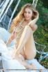 Heavenly cat wearing her pearls poses nude in the garden.