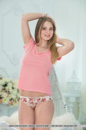 Skank in a pink shirt and flowery panties exposes her parts on a white swing. - XXXonXXX - Pic 1
