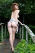 Beautiful damsel strips dress outdoors to rock…