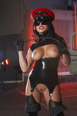 Wild busty brunette in a rubber outfit a - XXX Dessert - Picture 8
