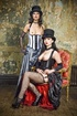 Two brunette sluts in vintage outfits and hats…