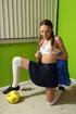 Playful girl with plaits and long socks enjoys…