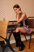 Nasty teen with plaits in a checked dress and high…