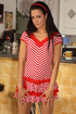 Brunette teen in a red and white striped dress…