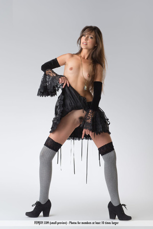 Teen doll in black lacy lingerie flashes her V against a grey background. - XXXonXXX - Pic 1