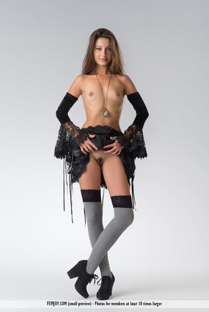 Teen doll in black lacy lingerie flashes her V against a grey background. - XXXonXXX - Pic 2