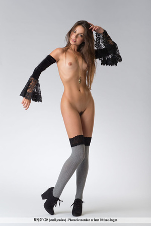 Teen doll in black lacy lingerie flashes her V against a grey background. - XXXonXXX - Pic 3