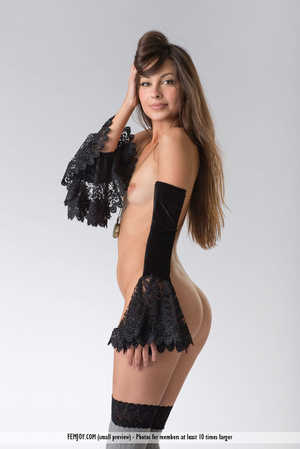 Teen doll in black lacy lingerie flashes her V against a grey background. - XXXonXXX - Pic 8