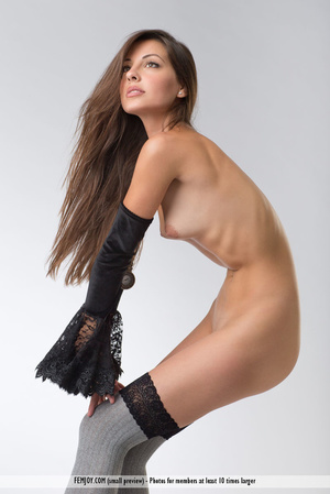 Teen doll in black lacy lingerie flashes her V against a grey background. - XXXonXXX - Pic 10