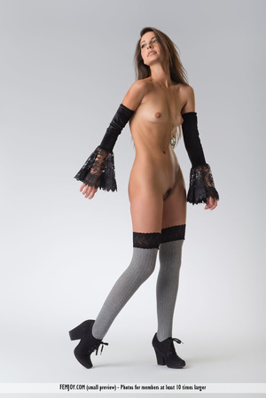 Teen doll in black lacy lingerie flashes her V against a grey background. - XXXonXXX - Pic 13