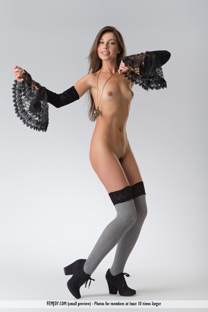Teen doll in black lacy lingerie flashes her V against a grey background. - XXXonXXX - Pic 14