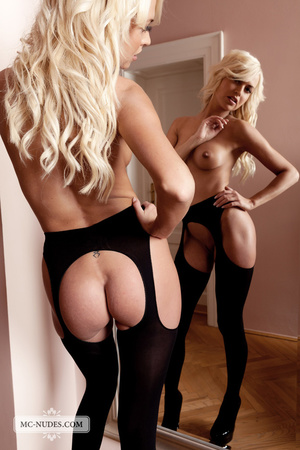 Foxy blonde chick posing alluringly while showing her hot boobs then exposes her hot pussy in black stockings and high heels by a mirror. - XXXonXXX - Pic 4
