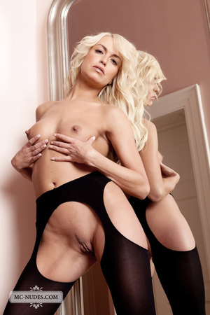 Foxy blonde chick posing alluringly while showing her hot boobs then exposes her hot pussy in black stockings and high heels by a mirror. - XXXonXXX - Pic 12