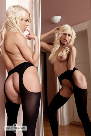 Foxy blonde chick posing alluringly while showing her hot boobs then exposes her hot pussy in black stockings and high heels by a mirror. - XXXonXXX - Pic 15